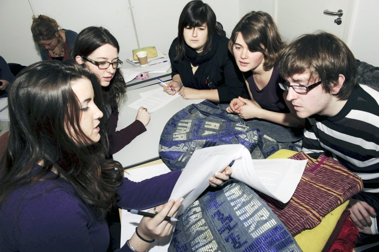Students Examining African Textiles